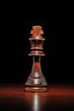 Illuminated wooden king chess piece Stock Photos