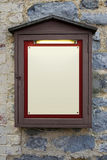 Illuminated wooden notice board Royalty Free Stock Photography