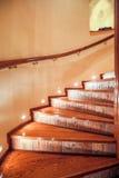 Illuminated wooden stairs Stock Photos