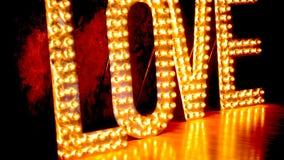 Illuminated word LOVE stock video footage