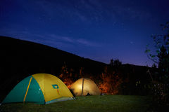 Illuminated yellow camping tent Stock Image