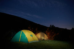 Illuminated yellow camping tent Stock Photos