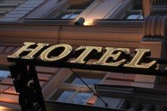 Illuminated yellow hotel sign Stock Image