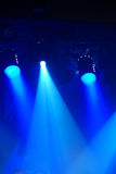 Illuminating. Blue light with spotlights illuminating the stage Royalty Free Stock Image