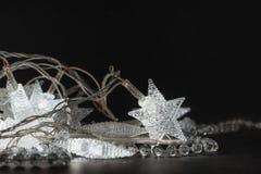 Illuminating crystalline stars and beads. On the black background royalty free stock photo