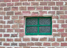Illuminating ground glass window on brick wall Royalty Free Stock Image
