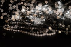 Illuminating stars and crystal beads in gold colors Royalty Free Stock Photos