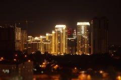 Illumination of building construction at night in city Royalty Free Stock Photos
