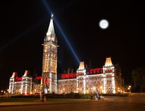The illumination of the Canadian House of Parliament at night Stock Images