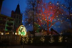 Christmas market in Cologne. Illumination of carousel and trees Stock Image