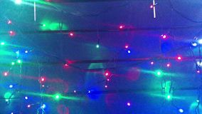 Illumination. Christmas tree garlands. Scenery with glowing, flashing lights. Dynamic, motion footage. Holiday movie.  stock footage