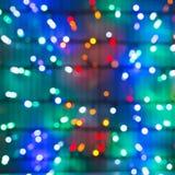 Illumination Defocused de Noël sur la fenêtre Photos libres de droits