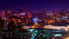 Time lapse. View from the roof of the ferris wheel which is beautifully illuminated by a bitter park in Rostov on Don
