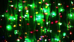 Illumination garland decoration blinking on heart shaped background stock video footage