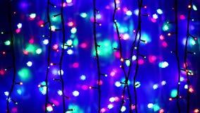 Illumination garland decoration blinking on snowflake background stock video