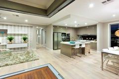 Illumination of the  Interior lighting in luxury house at night Royalty Free Stock Photos