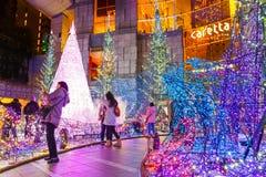 Illuminations light up at Caretta shopping mall in Odaiba, Tokyo. TOKYO, JAPAN - NOVEMBER 27 2015: Illuminations light up at at Caretta shopping mall in Shiodome stock photos