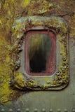 Illuminator on a rusty metal wall. Royalty Free Stock Photo