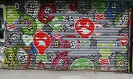 Illuminazione esplosiva di arte murala in poca Italia fotografia stock