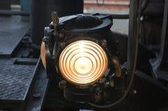 Illumini il treno del vapore Fotografie Stock