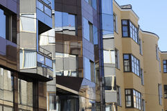 Illusion and the bent space of the city in its glass windows Stock Image