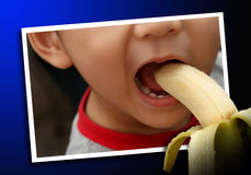 Illusion of a boy eating banana. Illusion of a boy inside the photo eating banana from outside Royalty Free Stock Image
