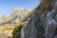 Illusion of dead-end road on the way to the old fortress. Kotor, Montenegro Royalty Free Stock Photo
