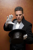The illusionist. The magician holding top hat Royalty Free Stock Photography