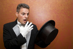 The illusionist. The magician holding top hat Royalty Free Stock Image