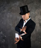 Illusionist man with cards fan Stock Images