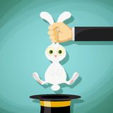 Illusionist pulls out a rabbit from a hat. Stock Vector cartoon Stock Photography