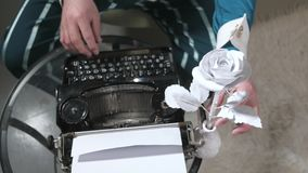 An illusionist writes on a typewriter holding a candle 4k stock footage