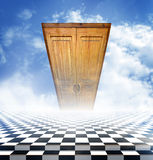Illusory landscape with a checkerboard floor and a closed door Royalty Free Stock Image