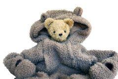 Illustrate too high costs in a company. Too big suit costs. Uncomfortable in the situation. This teddy bear feel the same Royalty Free Stock Photo