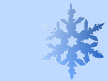 Illustrated blue snowflake. An illustration of a single, large blue snowflake isolated on a light blue background Stock Photo