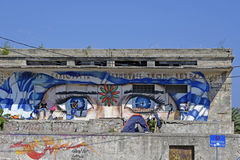 Illustrated building Lesvos Greece. Lesvos, Greece- October 05, 2015. Refugee migrants, arrived on Lesvos in inflatable dinghy boats, they stay in refugee camps royalty free stock image