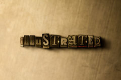 ILLUSTRATED - close-up of grungy vintage typeset word on metal backdrop Royalty Free Stock Image