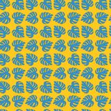 Illustrated seamless floral yellow background with blue monstera Royalty Free Stock Image