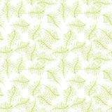Illustrated seamless background with green branches. Illustrated seamless pattern with green branches on a white background Royalty Free Stock Image