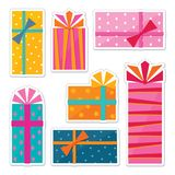 Series of sticker designs - illustrations of gift wrapped presents. Set of sticker designs with colorful illustrations of gift wrapped boxes with tied ribbon Royalty Free Stock Photography