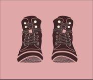 Illustratie Bruine laarzen Schoenen op een roze achtergrond stock foto