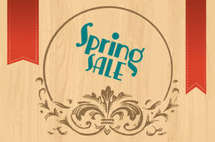 De verkoopteken van de lente op houten achtergrond met ornament vector illustratie