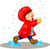 Jongen in de regen Stock Foto's