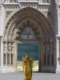 Angel with cross at the entrance in the cathedral church. Illustration of angel with cross at the entrance in the gothic cathedral Royalty Free Stock Image
