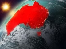 Australia on planet Earth in sunset. Illustration of Australia as seen from Earth's orbit during sunset. 3D illustration. Elements of this image furnished by Stock Image