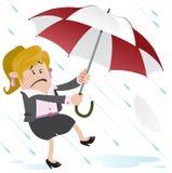 Affärskvinnakompis som bort blåsas med paraplyet Arkivfoto