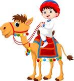 Illustration av den arabiska pojken som rider en kamel royaltyfri illustrationer