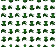 Illustration av en St Patrick Day Background Sömlös modell med växt av släktet Trifolium och hatten royaltyfri illustrationer