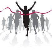 Den vinnande idrottsman nenen korsar mållinjen. Royaltyfri Bild