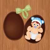 Baby in the Easter chocolate egg. Illustration of baby in the Easter chocolate egg Royalty Free Stock Photo